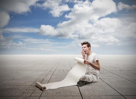 drowsiness: reading man Stock Photo