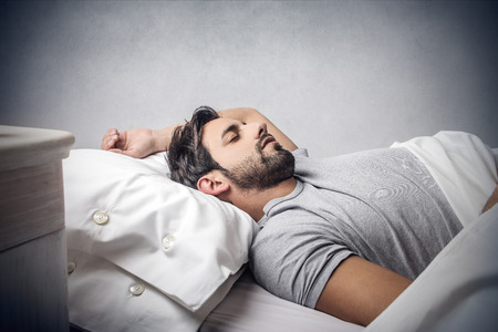 man: Man sleeping in bed