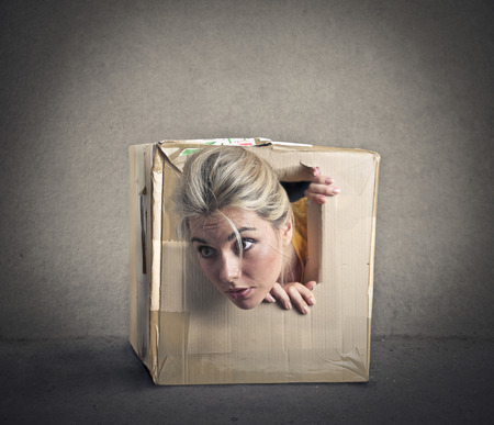 send to prison: Popping out of a small box Stock Photo