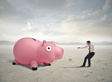 hard to find: Pulling a piggy bank Stock Photo