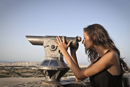 intresting: Beautiful girl observing the horizon