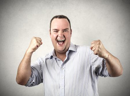 jubilating: Businessman happy for his success