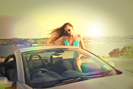 cabrio: Sitting in a car at the seaside Stock Photo