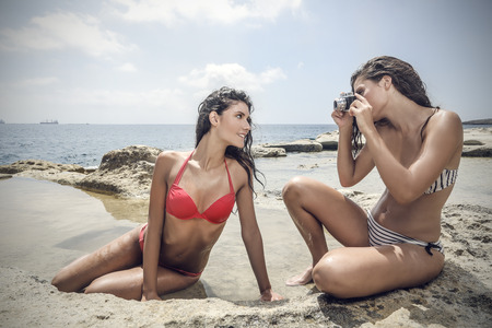 two women hugging: Two friends taking pictures of themselves