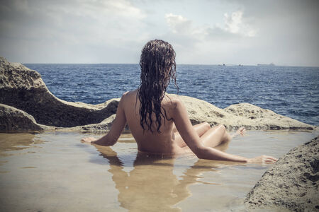 nude women: Watching the horizon