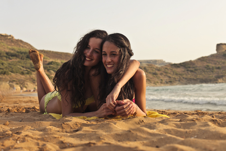 frienship: Two frinds at the beach Stock Photo