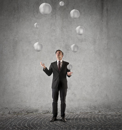 Juggling with white spheres photo
