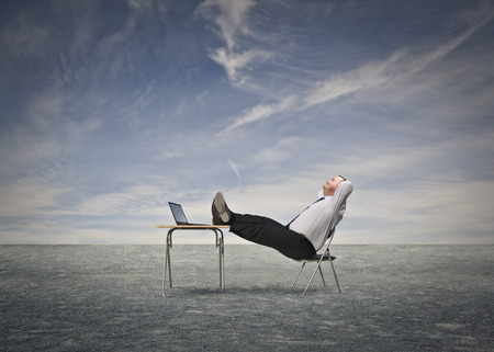 easy chair: Businessman relaxing in the desert Stock Photo