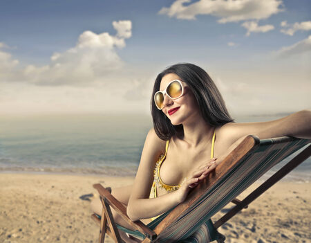 Woman wearing a yellow bikini photo