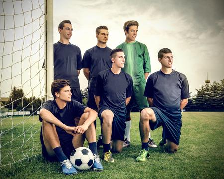 portero futbol: Equipo de f�tbol posando para una foto