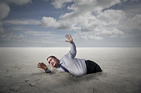 hard way: Businessman stuck in the desert