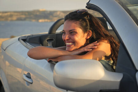 cabrio: Smiling girl in a car