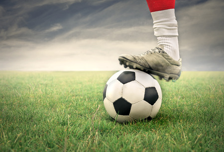 Soccer player legs with ball