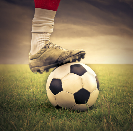 soccer sport: Soccer player legs with ball