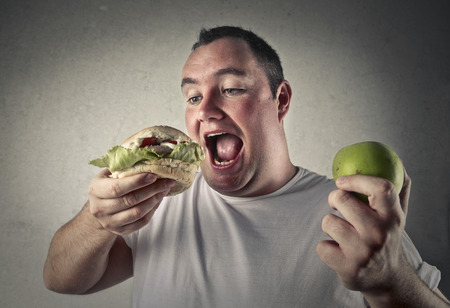fat: Apple and hamburger Stock Photo