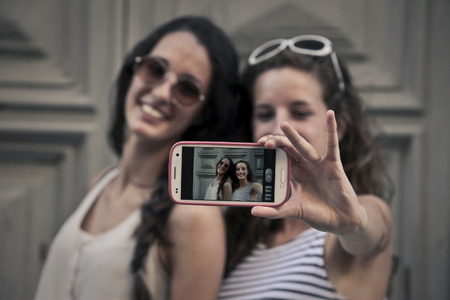 Two girls doing a selfie photo