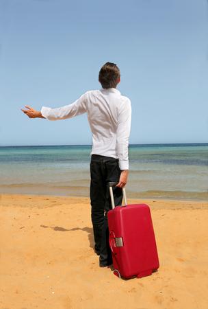 Man at the beach ready to go away photo