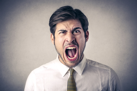 怒っている人 写真素材