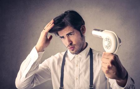 hair dryer: Blowing hair Stock Photo