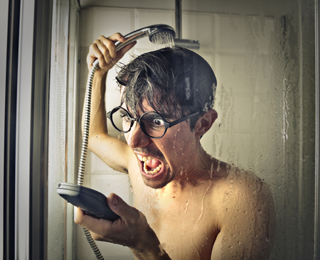 Yelling into the phone under the shower photo