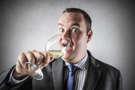 jubilating: Drinking a glass of wine Stock Photo