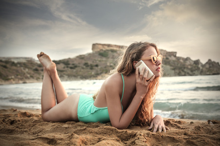 Talking on the phone at the beach photo