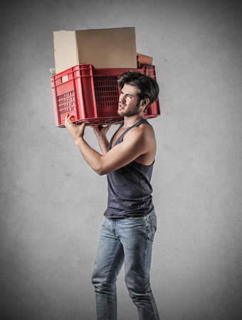 displace: Man carrying a box Stock Photo