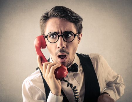 business concern: Surprised talking on the phone Stock Photo