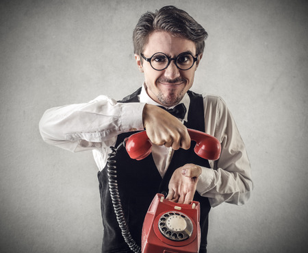 Man holding a red phone Stock Photo