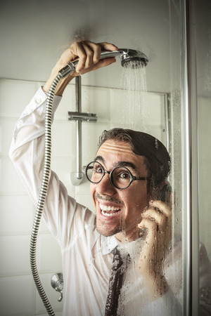 stupor: Smiling businessman in the shower Stock Photo