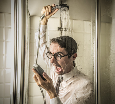 Man yelling at the phone in the shower photo