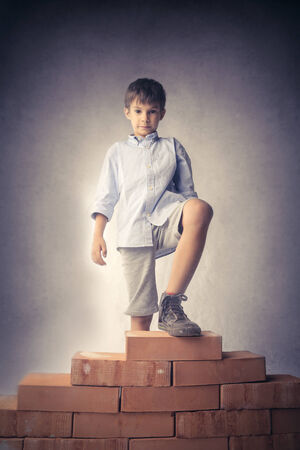 Little kid and a pile of bricks