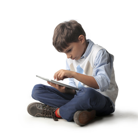 Little kid using a tablet Stock Photo
