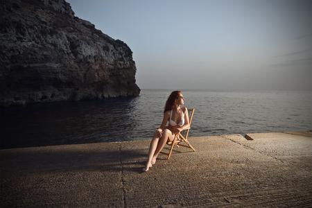Sitting at sunset photo