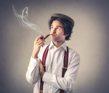 pipe dream: Smoking the pipe Stock Photo