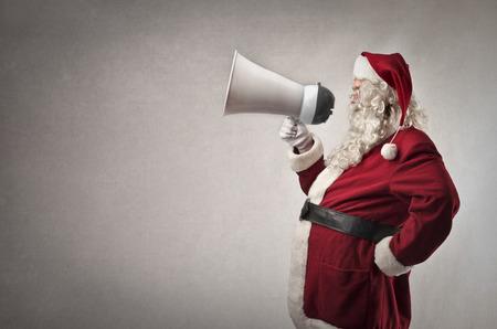 announcing: Santa Claus announcing something Stock Photo