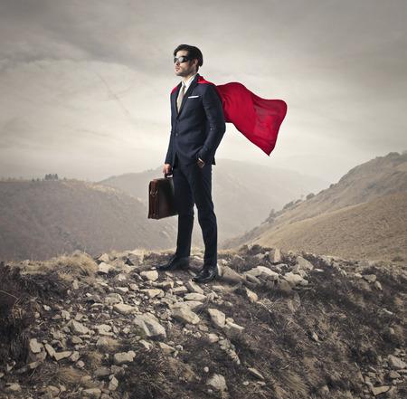 山の上のスーパー ヒーロー 写真素材