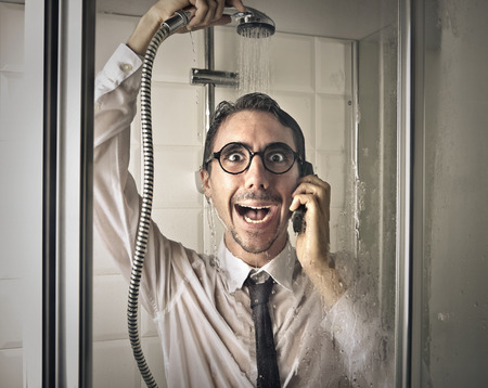 man shower: Excited businessman under the shower