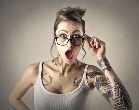 tattoo face: Surprised girl Stock Photo