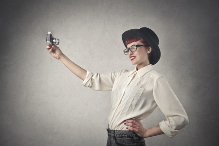 self conceit: Girl doing a selfie Stock Photo