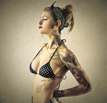 body piercing: Beauty posing in a swimsuit Stock Photo