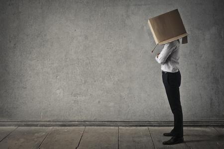 shyness: Hiding inside the box Stock Photo