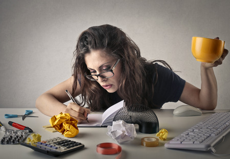chaos: Woman working in the office Stock Photo