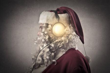 Santa listening to music