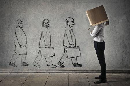 shyness: Businessman hiding in a box
