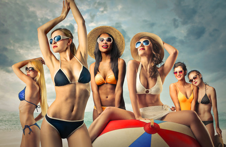 young girl bikini: Group of girls at the seaside Stock Photo
