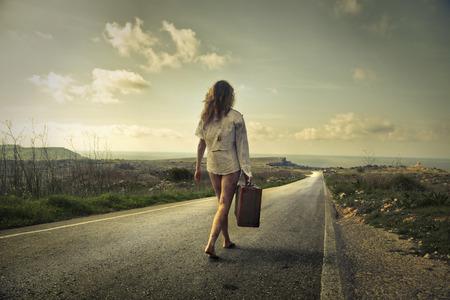 long road: Walking on a long road Stock Photo