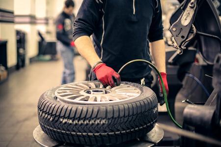 air pressure: Mechanic checking air pressure