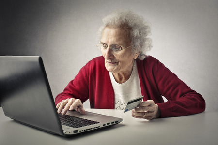 Elderly woman using technolgy Stock Photo