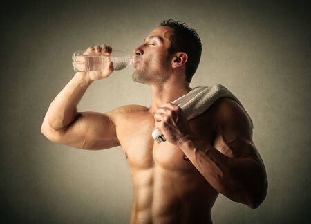 naked male body: Drinking water